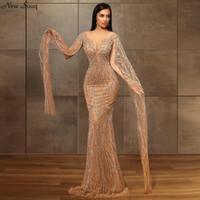 Musulmans Champagne manches longues sirène robes de soirée 2020 Sexy col en V profond Arabie Saoudite Sparkly pailletée Robes de soirée