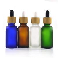 Les plus récents Populaire givré goutte Bouteilles 30ml 1 oz orange vert bouteille de pipette en verre d'huile essentielle bleu clair avec bouchon compte-gouttes en bambou
