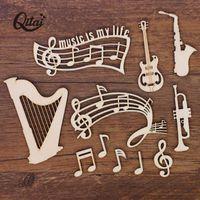 Dekorative Objekte Figuren Qitai 55pcs / Box Guitar / Harfe / Musiknote Holz Handwerksscheiben für Melodie DIY Scrapbooking Zubehör Handmade