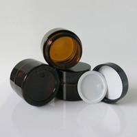 200 × 30G جرة كريم العنبر الزجاج مع غطاء أسود ، زجاجة الفم عرض 1 أوقية لمستحضرات التجميل