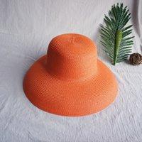 Damas sombrilla de sombrero de la vendimia del color puro estilo de Hepburn vacaciones 56-58cm temperamento elegante de moda de verano de alta calidad sombrero de paja
