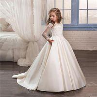 2020 Nuevos vestidos de niña de flores de marfil lindo lindo para boda Custom Hecho de nueva llegada Vestido de concurso caliente Mangas largas y apliques satinados