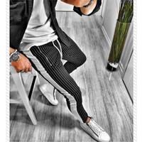 Pantalones de entrenamiento para correr los hombres rayados deporte Sweatpants pantalones cortos Pantalones largos ang hombres de la aptitud basculadores culturismo Crossfit