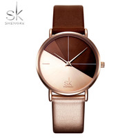 Relojes de mujer de Shengke Reloj de pulsera de cuero de moda Vintage señoras Reloj irregular Mujer Bayan Kol Saati Montre Feminino