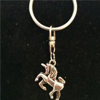 HOT شحن سريع! السحر يونيكورن الدوارة سلاسل المفاتيح الفضة خمر الحصان قلادة تتبع سلاسل مفاتيح DIY مجوهرات صالح 781