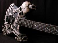 手彫りのJ Frog George Lynch頭蓋骨と骨電気ギターフルフローティング純正フロイドフロイドローズトレモロ、黒檀のフィンガーボード、韓国のハードウェア
