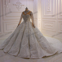 Luxury Long Sleeves Crystal Beaded Ball Gown Wedding Dresses Real Pictures Saudi Arabian Dubai Plus Size Bridal Gown Cathedral Train