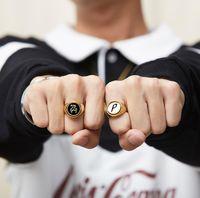 Palacio Hip Hop Rings P-logo Reversión Rotary Dedo Medio Anillo de aleación de doble cara