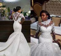 2020 Luxury African Mermaid Wedding Dresses Sheer Long Sleeve High Neck Crystal Beads Chapel Train Arabic Bridal Gowns Plus Size Customized