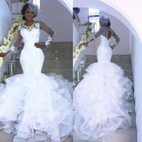 2020 Sheer Sexy See Through africaine Robes de mariée manches longues dos ouvert hiérarchisé Jupes Nigerian mariée Robes de mariée