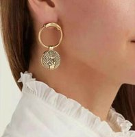 Famous designer gold earrings palm bronze circle asymmetrica...