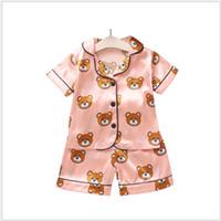 مصمم ملابس نوم الصيف للطفولة مجموعات الاطفال مصمم الملابس والفتيان والفتيات كارتون طفل الدب الرئيسية ملابس اثنين من قطعة قصيرة مجموعة ذات أكمام البدلة الطفل