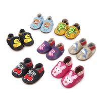 Nueva historieta del bebé mocasines de cuero genuino antideslizante suavemente único oso conejo cereza zapatos infantiles Zapatos primeros caminante del bebé 0-24M