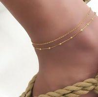 Delicated Frauen Fußkettchen Metallperlenstickerei Charm Layered Fußkettchen Armband barfüßigsandelholze für Mädchen / Damen (Gold, Silber)