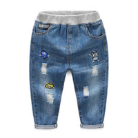 quality spring boys jeans pants kids fashion hole cartoon tr...