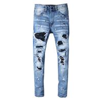 Jeans da uomo Jeans blu strappati elasticizzati distrutti Jeans da motociclista Patch uomo Pantaloni rotti Hip Hop Skinny Homme