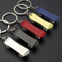 سلسلة لوح التزلج مفتاح سلسلة المفاتيح المعدنية الجديدة سكوتر الإعلان الهدايا الترويجية مفتاح حلقة حلقة مفاتيح قلادة مفتاح سيارة حامل 5 ألوان