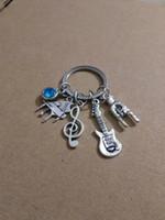 Großhandel blau stern stein Musik symbol / klavier / gitarre / rock geste Charme Schlüsselanhänger Ring Für Schlüssel Auto Tasche Schlüsselanhänger Handtasche Schlüsselbund A173