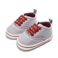 أحذية الكلاسيكية المرقعة قماش الطفل الوليد الطفل بنين الأولى مشوا طفل وحيد لينة المضادة للانزلاق أحذية لطيف
