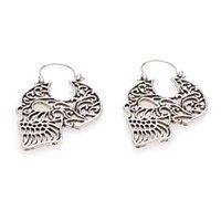 Europäische und amerikanische personalisierte Metall hohle geschnitzt Schädel Ohrringe heißen Verkauf seltsam Halloween Weihnachten Ohrringe Zubehör