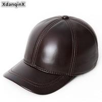 XdanqinX регулируемый размер мужская натуральная кожа шляпы зима теплая натуральная воловья бейсболки новый среднего возраста бренды язык крышка