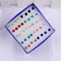 20 pares de aretes coreanos en caja, hombres y mujeres, pendientes antialérgicos de diamantes, pendientes de plástico para enviar tapones para los oídos.