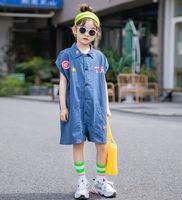 Verano grandes niños dibujos animados carta apliques muntas de moda chicas viejas solapa denim azul carga pantalones cortos de carga niños algodón soft ocasional mono a2560