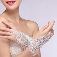 AUF LAGER Günstige Fingerlose Handgelenk Länge Spitze Brauthandschuhe Blink Perlen Elfenbein Weiß Hochzeit Handschuhe Hochzeit Zubehör