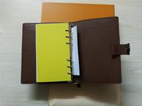 Ordre du jour célèbre marque note couverture en cuir journal en cuir avec sac à poussière et boîte carte carnets carnets vente chaude style bague en argent L243