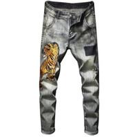 Mens Tiger Patches emblema bordado Ripped Skinny Jeans Vintage Lavados estiramento Denim Jeans slim Calças Hip Hop
