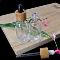 30ML 투명 유리 에센셜 오일 스포이드 병 화장품 피펫 컨테이너 포장 병 에코 친화적 인 나무 대나무 뚜껑
