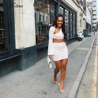 Hugcitar одно плечо с длинными рукавами клеш культур топы юбки 2 шт. Комплект 2018 осень зима женщины мода твердые сексуальные повседневные комплекты