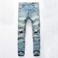Der Großhandelsmänner Jeans Jeans gießen hommes Gezeiten Loch nostalgisch groß zerfetzten Jeans-Hosen der Männer kausalen Hosen