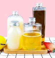 Botella de plástico de bebidas de jugo 250-550ml botellas transparentes botellas cuadradas redonda plana de agua a prueba de fugas taza de la bebida con la tapa 200pcs GGA3486