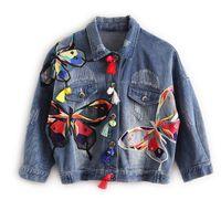 Bunte Schmetterlings-Stickerei-Dame Jean-Jacken-Flecken-Entwürfe der Frauen Denim Mäntel mit Quaste ausgefranste dünne Jacke Blau