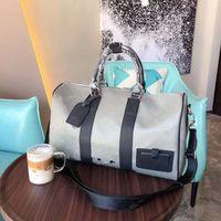 2020 التيتانيوم جديد سبيكة 47 سم عقد للجميع حقائب M44170 القماش الخشن اليد حقيبة سفر الرجال واق من المطر حقيبة تحمل على الظهر