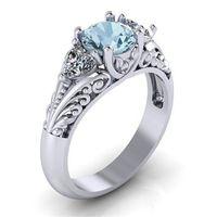 愛のダイヤモンドのリングの花立方ジルコニアの心の婚約の結婚指輪のためのウェディングリングの女性ファッションジュエリー意志と砂の贈り物