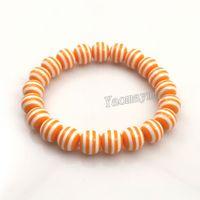 Braccialetti in rilievo della resina della zebra della banda 10mm di colore arancione all'ingrosso 10pcs / elastico per regalo di Natale Trasporto libero