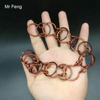 9 번 반지 말굽 모양의 손으로 만든 와이어 퍼즐 빨간 구리 금속 퍼즐 솔루션 장난감 (모델 번호 H409)