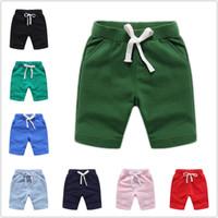 12 colores Pantalones cortos para niños de verano bebés varones sólidos europeos y americanos pantalones cortos de cintura elástica pantalones cortos para niños