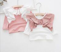 iss كوريا فتاة الاطفال ملابس قميص جولة الياقة كم طويل الكشكشة تصميم قميص الصيف فتاة لينة 100٪ قطن قميص
