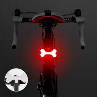 Красный + синий светодиод USB Аккумуляторная Bone Triangle Bike Задний задний фонарь Велосипед 5 режимов Ночная безопасность Велоспорт Сигнальная лампа водонепроницаемый