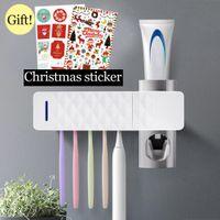 Großhandel Badezimmer automatische Zahnpasta-Zufuhr-Sterilisator UV-Licht UV-Zahnpasta-Quetscher Zahnbürstenhalter Reiniger