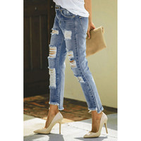 New high- waisted vertical jeans worn through the foot high a...