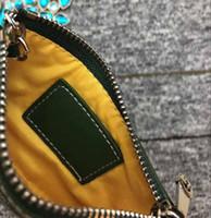 أحدث الأزياء باريس نمط جودة عالية محفظة مصمم الجلود قماش عملة الحقيبة الرجال النساء العملات محفظة مصغرة محافظ قصيرة البريدي حقيبة صغيرة