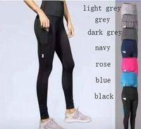 Envío gratis UA Sports Wear Malla Pantalones de yoga para mujeres Cintura alta Legging Fitness Ropa femenina Fitness Leggins Deporte Gimnasio Leggings Medias