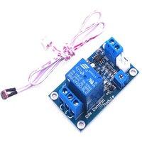 3pcs / lot Interruttore XH-M131 DC 5V controllo della luce / 12V fotoresistore Modulo relè rilevazione del sensore di luminosità 10A modulo di controllo automatico