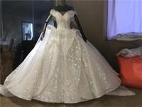 Immagini reali Dubai Arabo Lusso 2019 Abiti da sposa con lacci sul retro Sexy Bling Applique in pizzo con spalle scoperte Abito da sposa Cappella Abiti da sposa