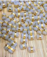Gold eingelegte Jade und Tian Yu Road Road Anhänger weißer Jade Transfer Perlen DIY lose Perlen freies Verschiffen F4 passieren