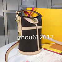 حقيبة واق من المطر حقيبة جلدية M43587 الكتفين قطري الاتجاه عبر البلاد البرية الساخنة ميكائيلا نيكولا إمرأة المحافظ دلو الزهور CROSSBODY حقيبة